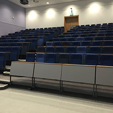 Lecture theatre with rows of straight desks