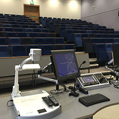 Lecture theatre desk with computer screen