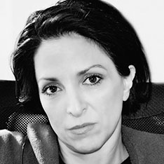 Black and white headshot of Maria Vogiatzaki