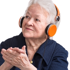 Old woman clapping while listening to music