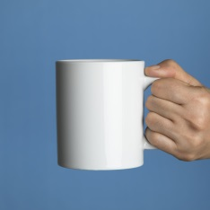 Holding a mug of coffee