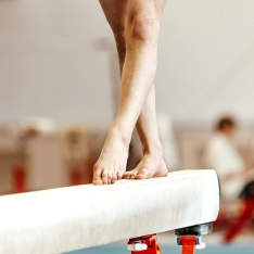 A gymnast balancing on apparatus