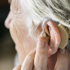 Older person wearing a hearing aid