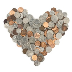 Coins arranged in the shape of a heart
