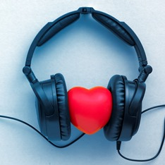A set of headphones on a cartoon heart