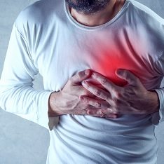 Man clutching his chest in pain chest pain