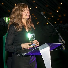 Julia Woolf receiving her award