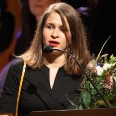 Kristin Roskifte on stage in Stockholm after receiving her award