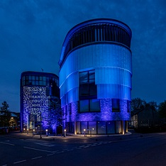 ARU's Young Street building, lit up blue in support of the NHS. Photograph by Martin Bond