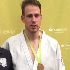 Mateja Glusac wearing his medal.
