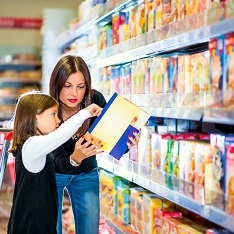 Woman and daughter looking at a cereal packet