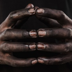 Clasped hands. Photograph by Edith Chiliboy