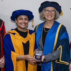 Dr Madhumita Pandey receiving the Ruskin Medal from Professor Aletta Norval