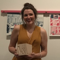 Sophie Burrows with her award and winning work