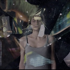 Image of a girl surrounded by glass shards from The Crossing