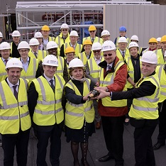 Staff at Anglia Ruskin and Morgan Sindall pour champagne at the topping out ceremony of the Science Centre
