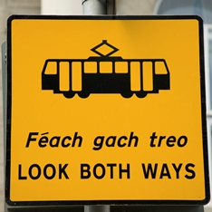 Tram sign in English and Gaelic