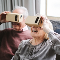 Pensioners using virtual reality viewers