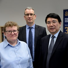 Professor Helen Valentine, Professor Roderick Watkins and Yongli Wang smiling for camera