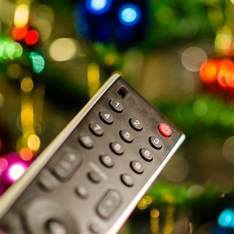 Remote control with Christmas tree in the background
