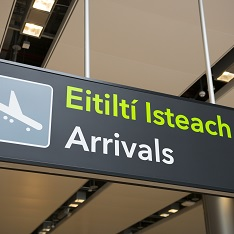 An 'Arrivals' sign in an airport terminal