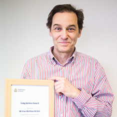 Uwe Matthias Richter with his long service award certificate