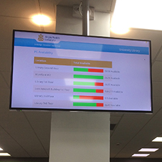 large screen displaying where free seats are available in the library
