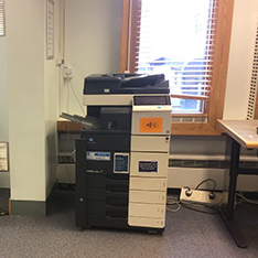 large photocopier in front of a window