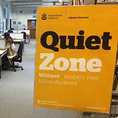quiet study zone sign in an open desk area