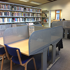 desks separated by dividers in a library