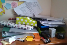 A desk full of papers and assignment work