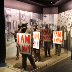 Statues of protesters holding signs that read I am a man