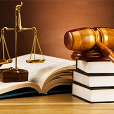 Law textbooks, gavel and scales of justice