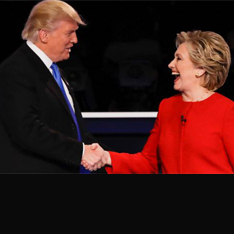 A photo of Donald Trump and Hilary Clinton shaking hands.