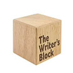 A wood box with Writers Block written on the centre
