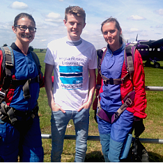 Senior Law Lecturer Michelle McCanna and students Luke Collis and Anna South in front of an aeroplane