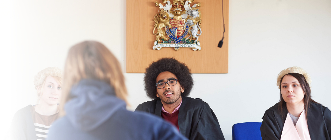 Anglia Ruskin students roleplaying a hearing in the mock courtroom