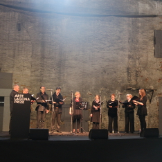 A group of people on stage at the Arsenale, Venice