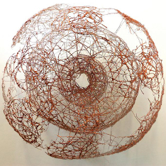 Torrus II by Michalina Paveley, a large copper wire sculpture in a semi-organic, circular form