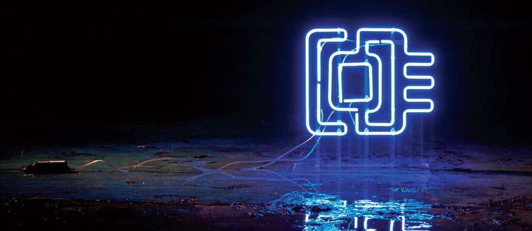 The Cultures of the Digital Economy (CoDE) electronic logo on a dark background, and its reflection in a puddle