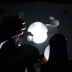 Cropped screenshot of Signals by Karolina Raczynski, an interactive performance using mirror signalling and live video feed