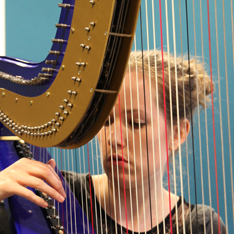 Una Monaghan playing the harp