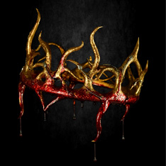 A crown, dripping with blood, set against a black background