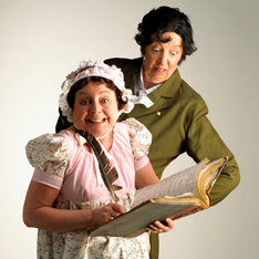 two women, comically dressed to represent Jane Austin and Mr Darcy, pose with a book