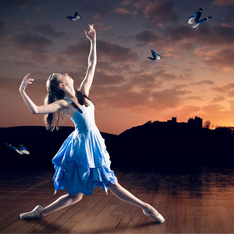 a ballet dancer, mid pose, with birds flying around her.