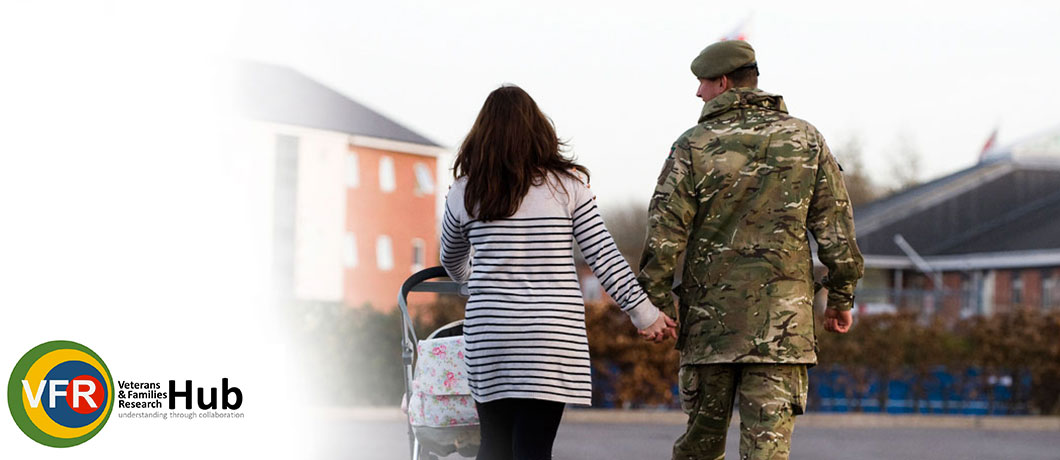 Soldier walking with down a residential street with his family.