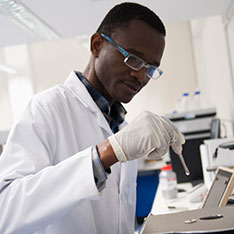 Student in the lab with a pipette