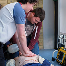 Two paramedic students practising CPR