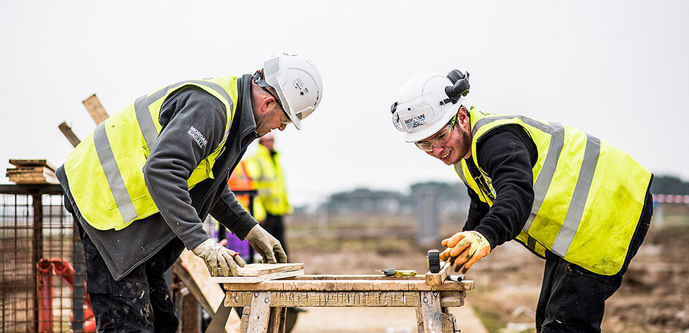 Student working with a professional at the Constructionarium