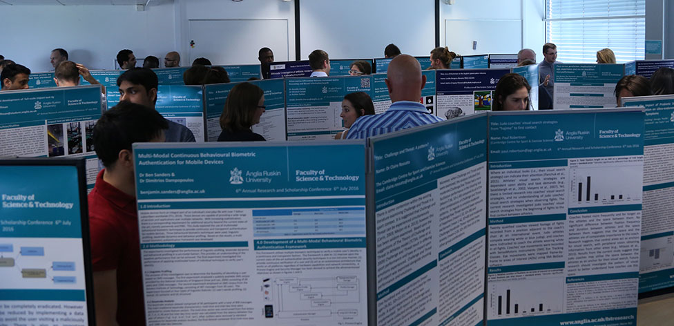 Delegates reading some of the 89 conference posters submitted by staff and students within the faculty.
